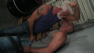 man sniffing silver daddy's armpit