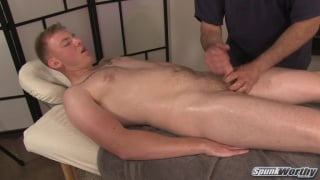 guy with beefy thighs gets handjob on massage table