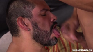 smooth twink cums on his daddy's beard