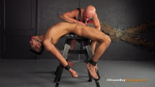 bald master sucks his slave's cock who is laid over a bench