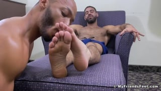 handsome hairy  hunk gets his bare feet licked & worshipped