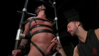 two guys edge a bound sub until he's begging to cum
