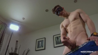 chiseled hunk wearing an eye mask jacks off