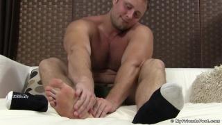 Beefy Hunk Rubs His Sore Bare Feet