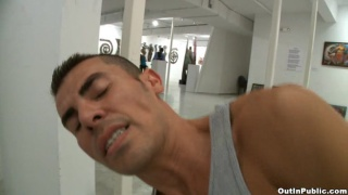 Gay men fuck in public at a Art gallery