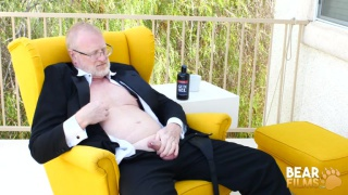 daddy bear sitting back in his suit and jacking off