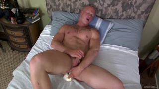 stud loves playing with his nipples while stroking his cock