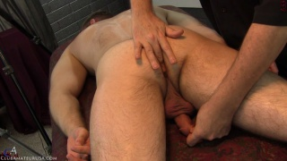 straight guy on his stomach gets some unique cock play