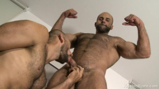 top man plunges his huge cock head into guy's hairy ass