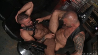 muscled leather man brings a hot man to his playroom