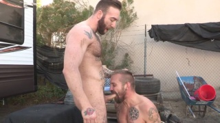 inked bearded guy sucks cock outside before getting fucked