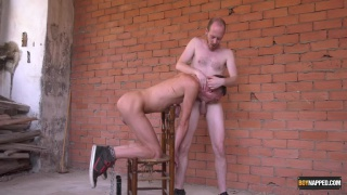 slave boy kneeling on a chair sucks dick before getting fucked