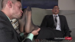 cute guy sniffs another dude's socked feet