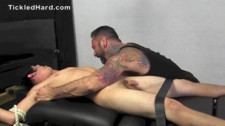 strapped down, guy gets his under arms tickled