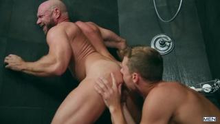 bald hairy man riding a blond jock's cock