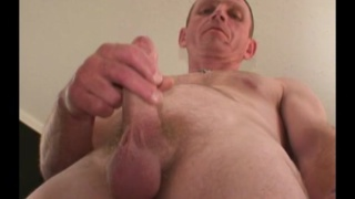construction worker jacks his cock in his first JO video