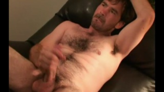 furry man squirts lube on his hard cock & jerks