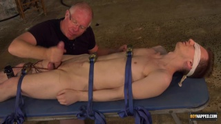 master makes use of restrained twink's big uncut cock