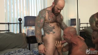 heavily-inked daddy gets his giant fat cock sucked