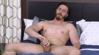 bearded gay dude strokes his big cock