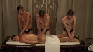 guy gets massage from three guys and then ...