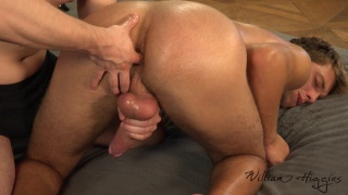 masseur sticks his oily fingers into this lad's tight butt hole