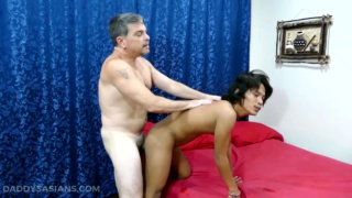 daddy bends his asian boy over the bed & fucks him