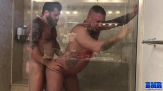 bearded man nails his lover in the large shower