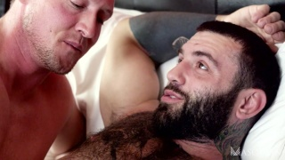 bearded inked hunk takes a giant cock up his ass