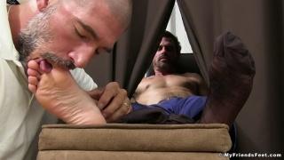 man slips his feet through curtains & gets them worshipped