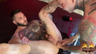 Sexy Muscle Hunk's Tattooed Arm Disappears in Hairy Man's Ass