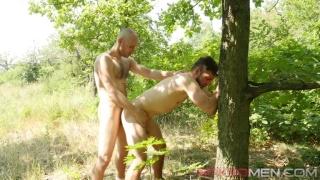 Naked Man in Orange Sneakers Gets Fucked Against Tree