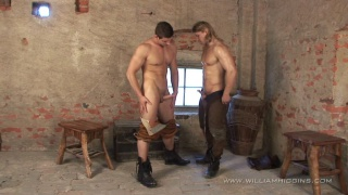 William Higgins presents two muscled hunks