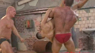 bodybuilders wrestle with twink