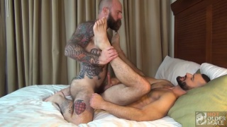 heavily inked bald daddy fucks muscle daddy's ass