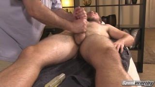 guy gets his thick cock worked on massage table