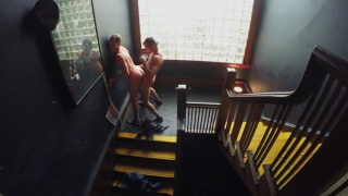 guy leans against wall in stairway & gets fucked