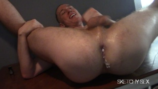 cum pig pushes jizz out of his ass at an orgy