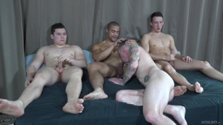 three guys cum on guy's inked chest