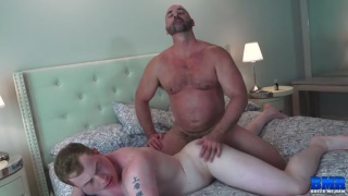 muscle bear pushes guy down on mattress & fucks him raw