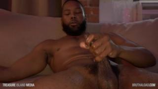 bearded ebony muscle hunk strokes his fat cut cock