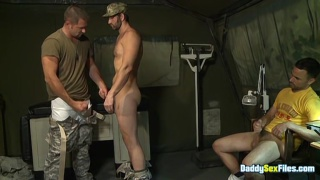three military men in cock-sucking session