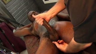 black stud's cock is hard before this massage even begins