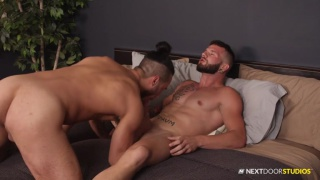 bearded guy gets head before anal sex with inked hunk