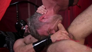hairy hunk's fat cock tied with rope then tortured with hot wax