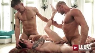 Tattooed Lad Gets Spit-Roasted Bare by Muscle Men