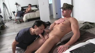 Hunky Ex-Marine Sits on Bed & Gets Sucked Off