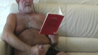 Silver haired daddy plays with cock