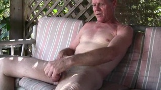 Older guy jerks outdoors