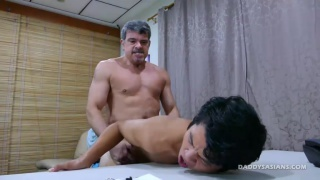 daddy bends his asian boy over office desk and fucks him